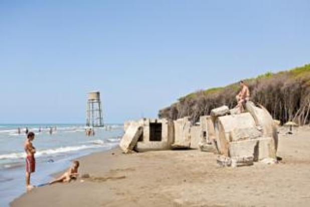 The ruins of bunkers in Albania on a beach