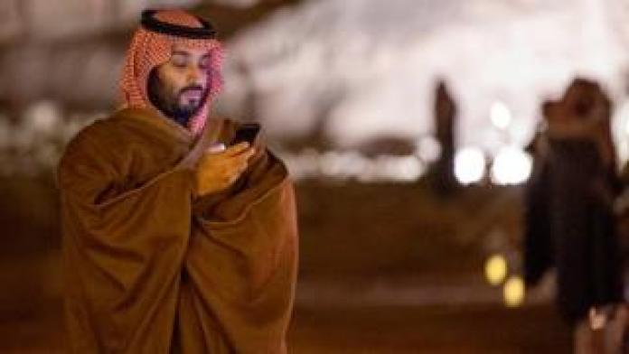 Bin Salman uses his phone