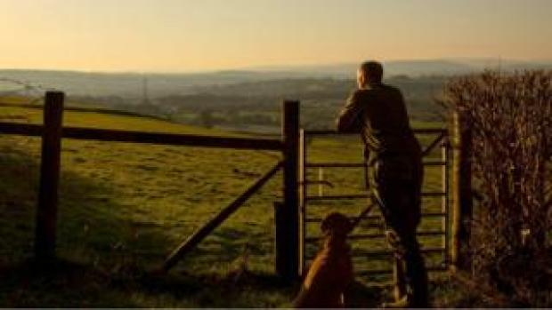A man and his dog taking a permitted walk in the Vale of Glamorgan