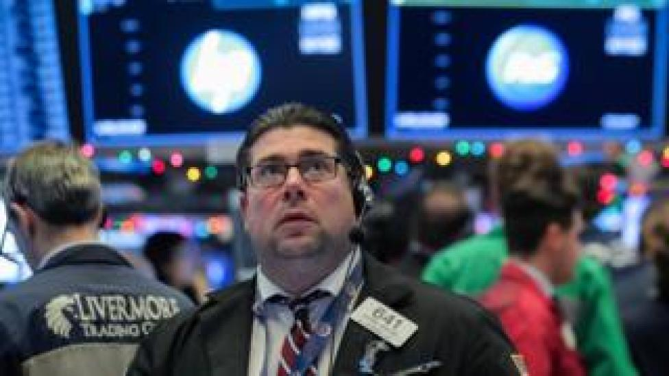 Traders work on the floor of the New York Stock Exchange (NYSE) in New York, United States, December 7, 2018.