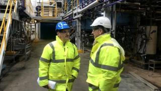 2 men in high vis and hard hats at chemical factory