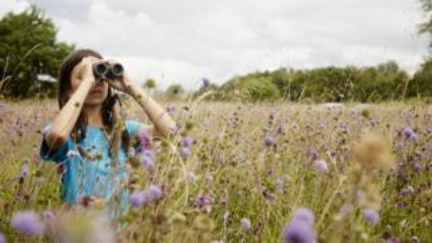 Mya-Rose Craig with binoculars