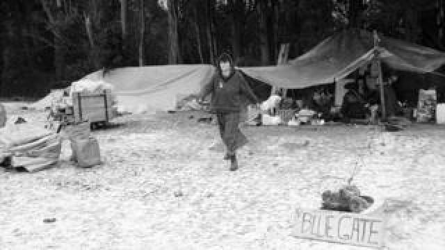 Woman on blue gate camp