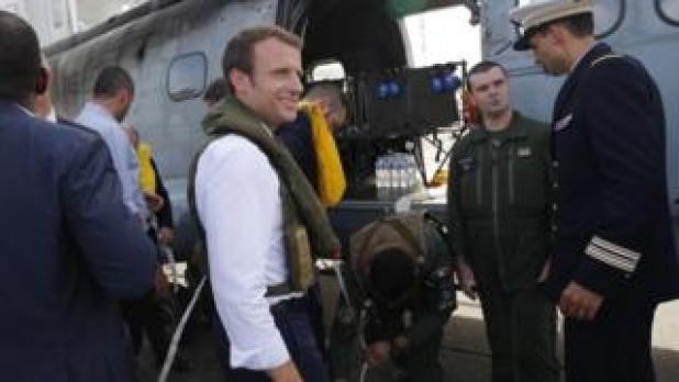 President Emmanuel Macron boards a helicopter towards the French Caribbean islands of Saint-Martin and Saint-Barthelemy, 12 September