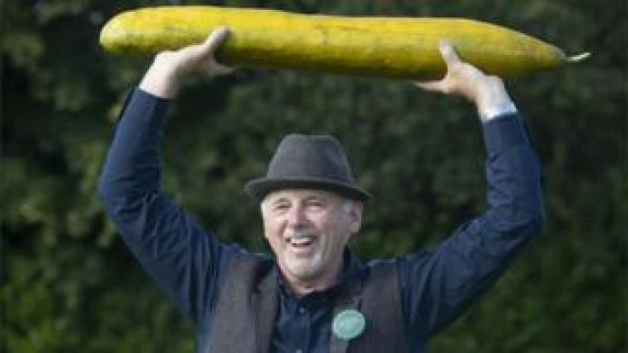 Graham Barratt with his winning giant cucumber, 920 mm long, after winning first prize