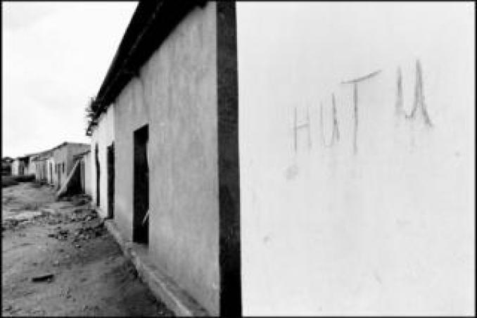 """A wall with the word """"Hutu"""" written on. Hutus living in this house scrawled their ethnicity on the wall to prevent looting"""