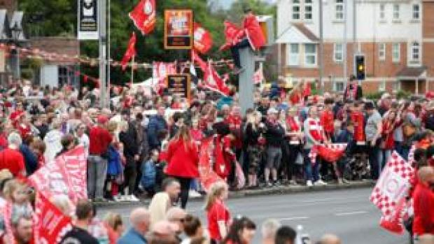 Several fans have lined the route through Liverpool