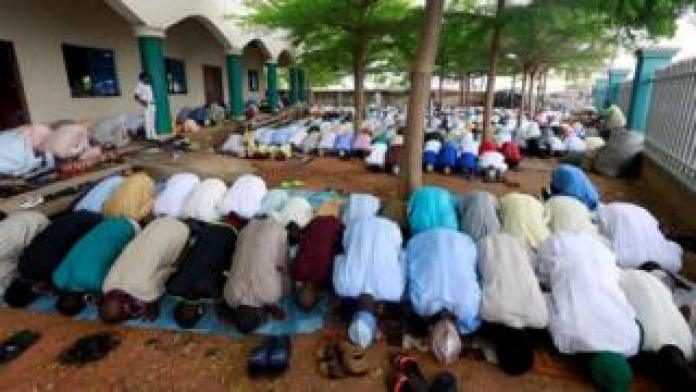 Muslims in Nigeria perform Eid prayer after the lockdown following the global outbreak of coronavirus disease (COVID-19) in Nasarawa, Nigeria May 24, 2020.