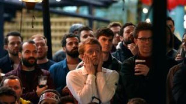 Red Rose supporters react as they watch the match at Flat Iron Square, in London
