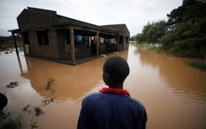 Agiro Cavanda looks at his flooded home in the aftermath of Cyclone Kenneth, at Wimbe village in Pemba, Mozambique, April 29, 2019