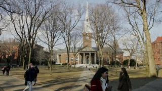 Harvard students walk through the university campus. File photo