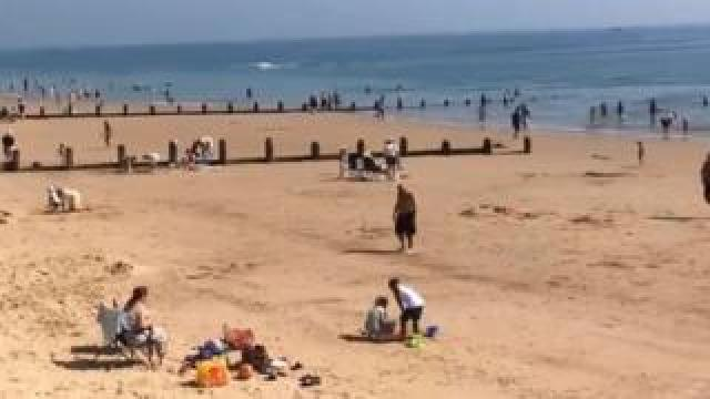 Beachgoers at Frinton beach.