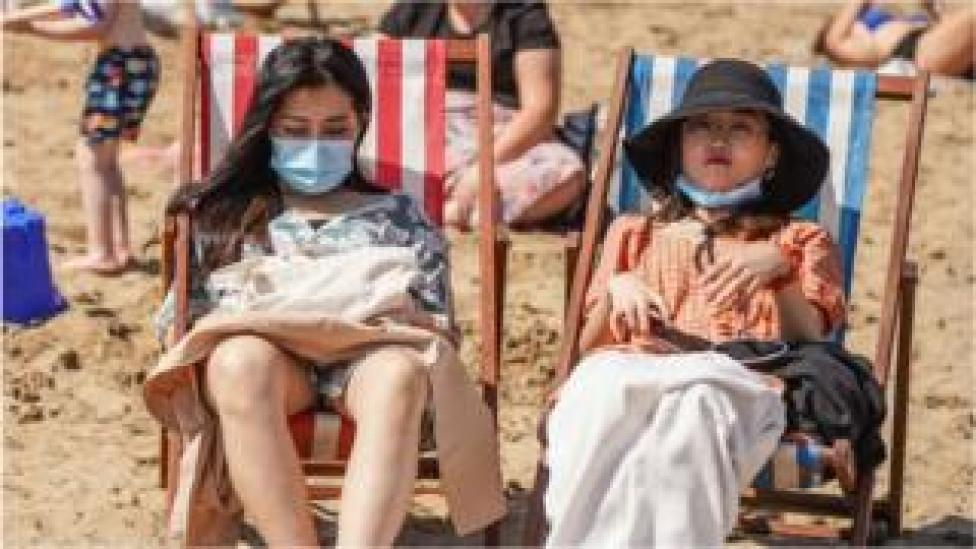 trump People on the beach with facemasks