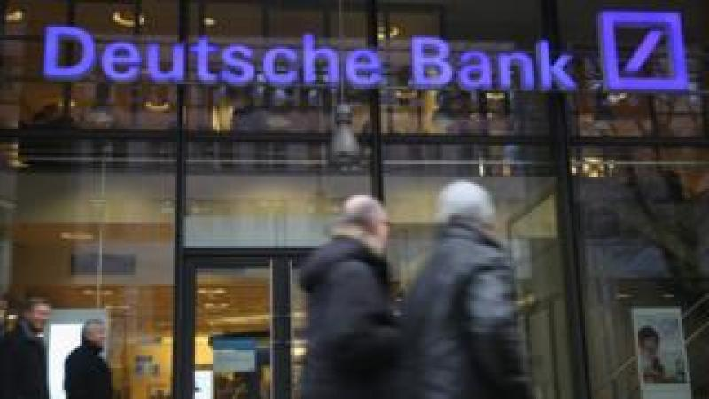 People walk past a branch of Deutsche Bank on January 17, 2014 in Berlin, Germany.
