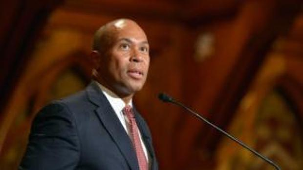 Deval Patrick stands at a podium