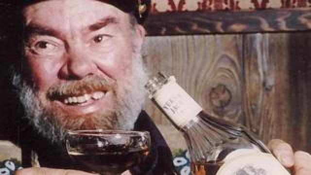 Captain Dick Stevenson pouring himself a drink