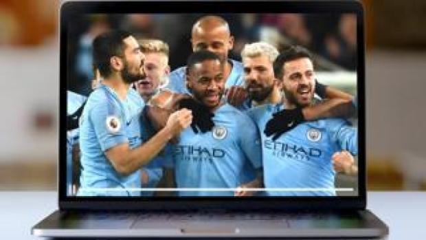 Man City players celebrate on a laptop