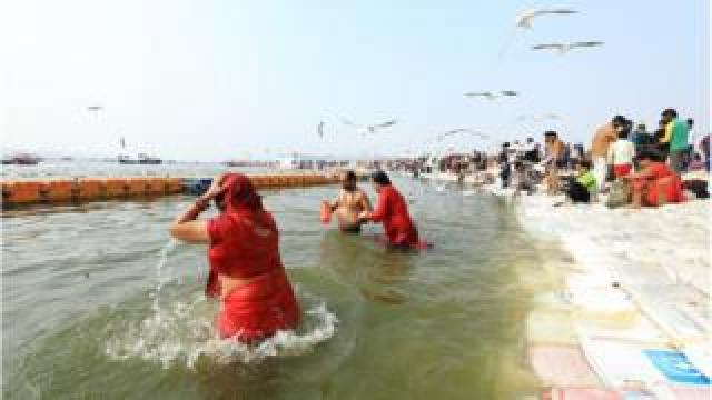Pilgrims taking a dip at the Kumbh Mela 2019