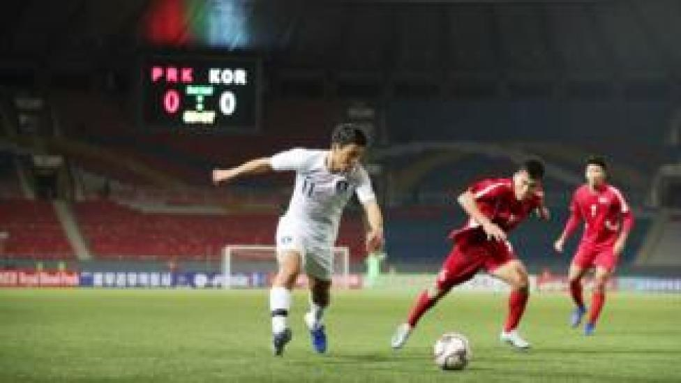 sport South Korea v North Korea match in front of empty stadium