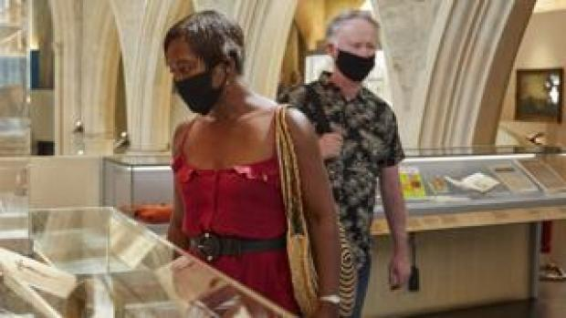 Museum visitors wearing masks