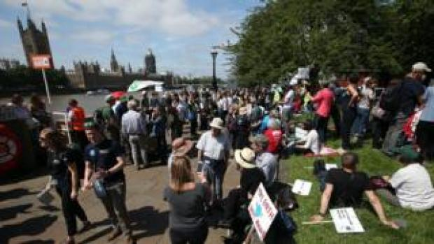 Protesters gathered on Albert Embankment in London before heading to Parliament