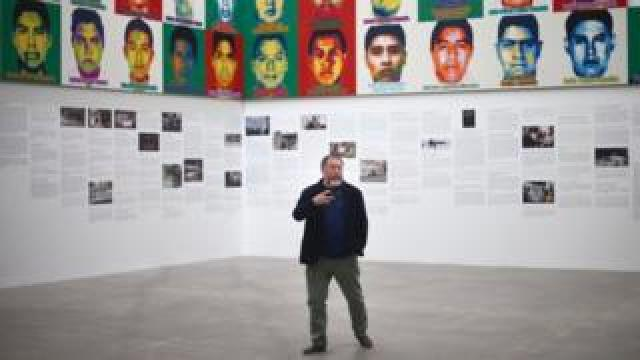 Ai Weiwei poses for photos