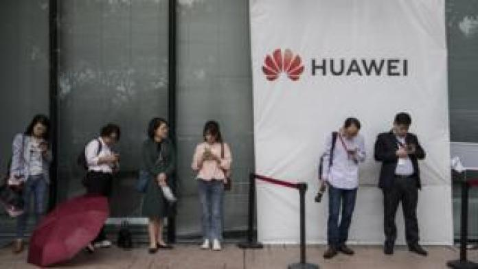 Huawei staff look at mobile firms at firm's campus in Shenzhen, China, 12 April 2019
