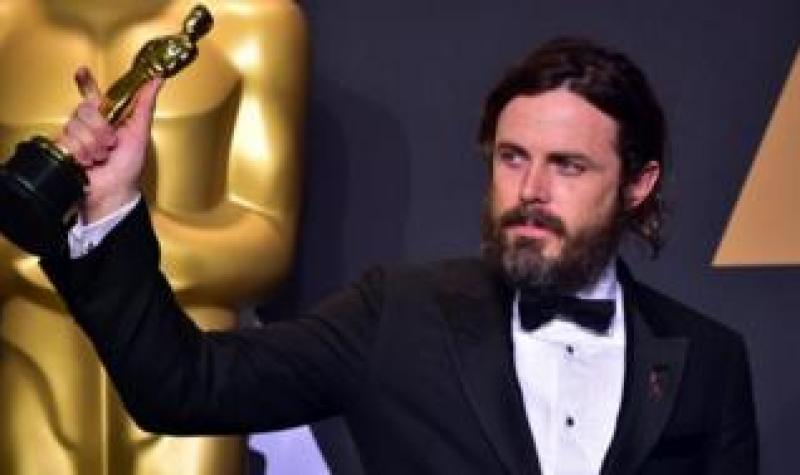Casey Affleck pictured with his 2017 Oscar for Best Actor