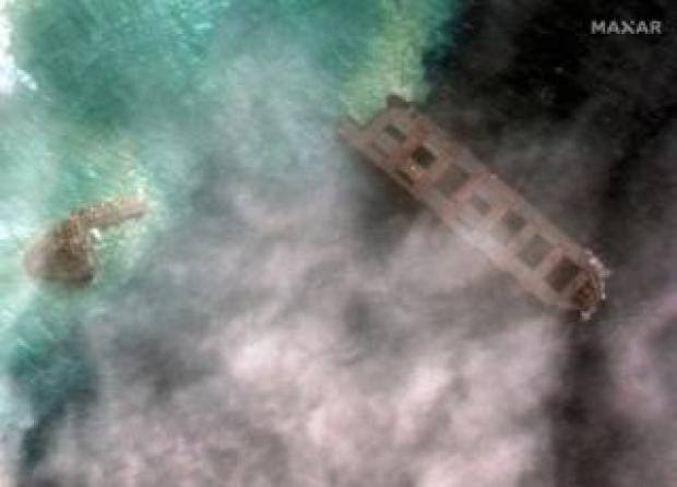Satellite image shows tug boats and Japanese bulk carrier MV Wakashio