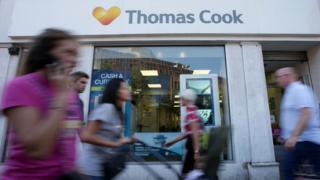 _104613323_thomascookshopafp Thomas Cook says Brexit hitting holiday plans