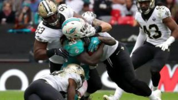 Jay Ajayi takes a tackle