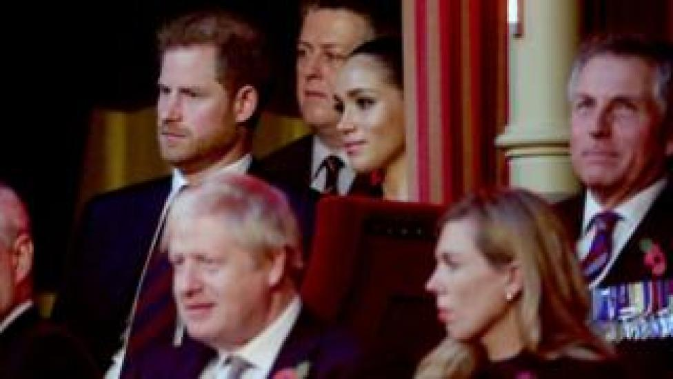 Prince Harry and Meghan sat in the Royal Box, behind the prime minister and his girlfriend Carrie Symonds (foreground)