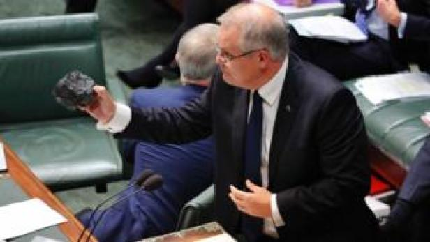 Scott Morrison holds a lump of coal in parliament in 2017