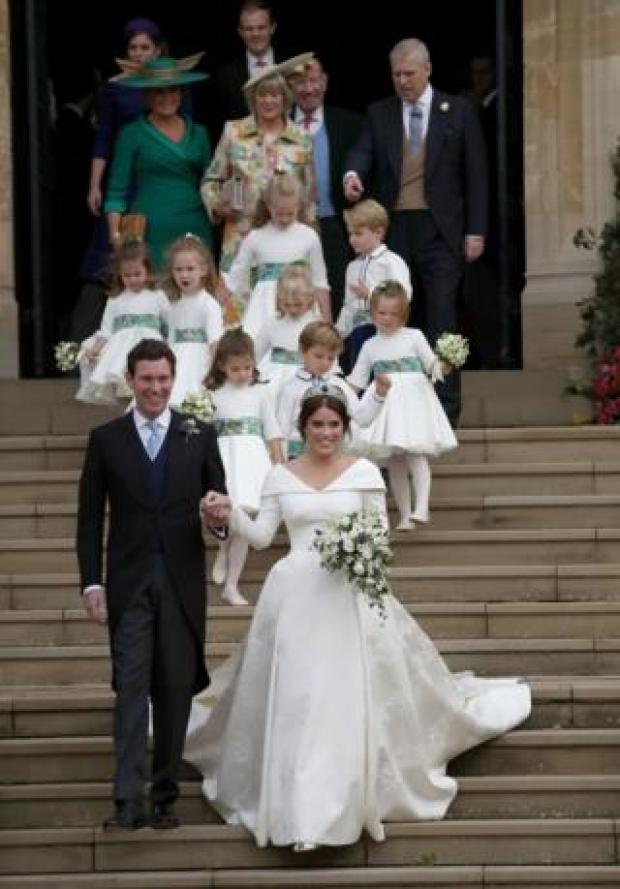 Jack Brooksbank and Princess Eugenie leave St George's Chapel