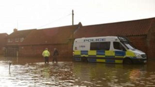 Police van in flood-hit Fishlake, South Yorkshire