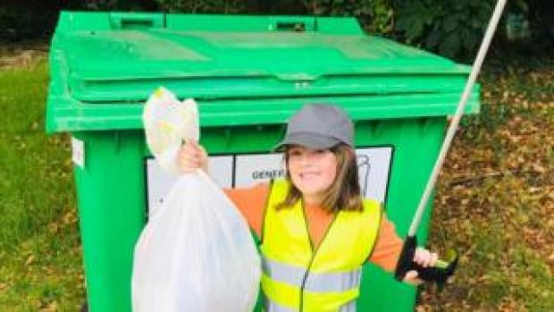 Olivia Shannon with her litter-picker and bag of rubbish