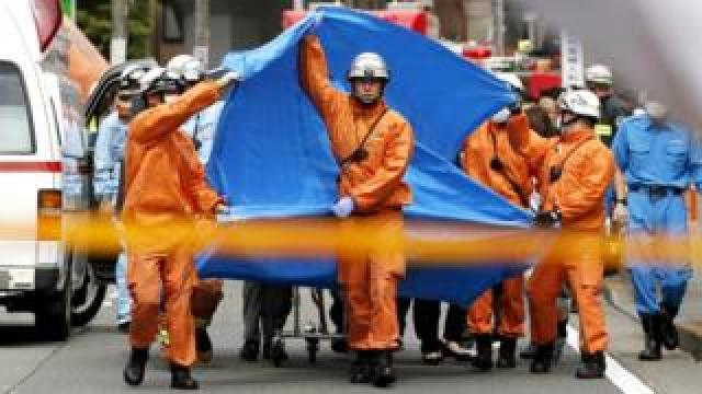 Rescue workers operate at the site where sixteen people were injured in a suspected stabbing by a man, in Kawasaki, Japan, 28 May 2019