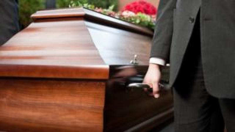 Man holding coffin
