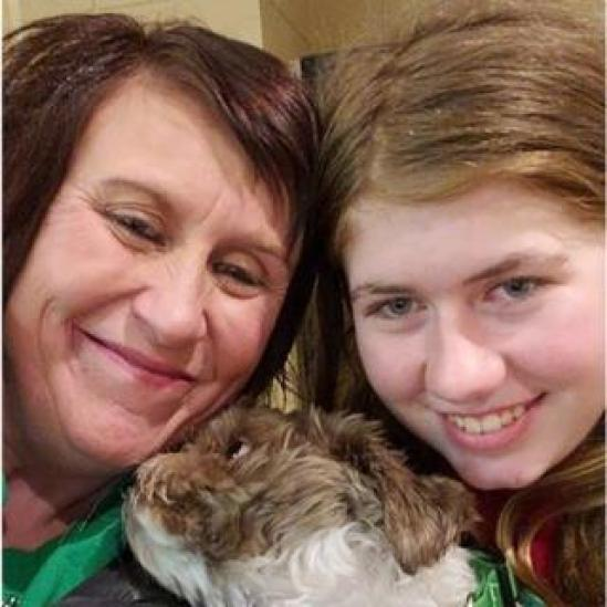 Jayme Closs (R), her aunt/godmother Jennifer Naiberg Smith (L) and Molly the dog posing together after being reunited on January 11