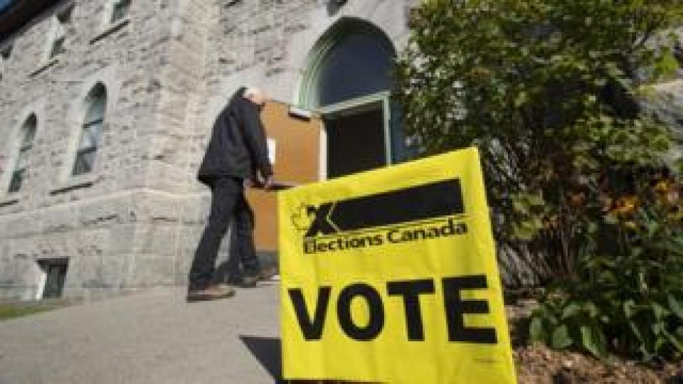 A voter walks into a polling station in Canada