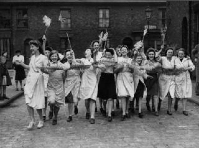 Workers celebrate in the street