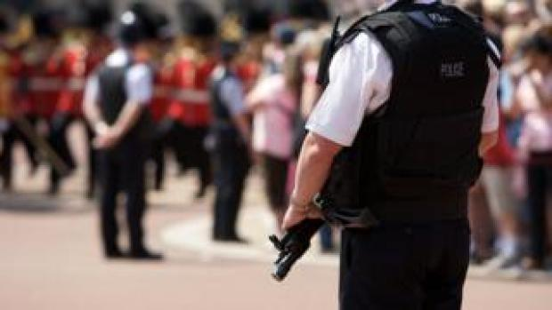 Armed police outside Buckingham Palace