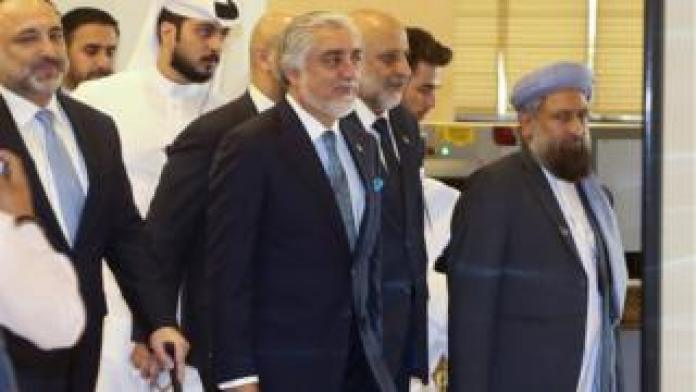 Food Afghanistan Peace Grand Council chief, Abdullah Abdullah (C) arrives for the opening session of the peace talks between the Afghan government and the Taliban in Doha, Qatar, 12 September 2020