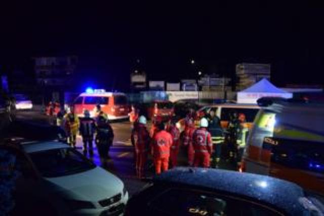Emergency workers attend the scene in Luttach