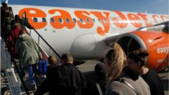 Passengers board an Easyjet flight
