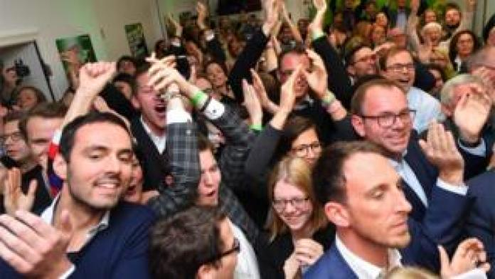 Green Party supporters celebrate after a Hesse exit poll