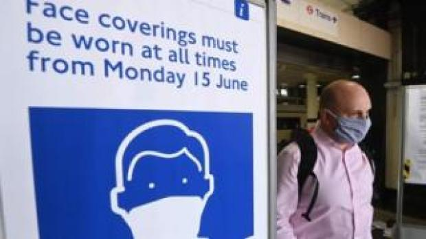 Man wearing mask on public transport