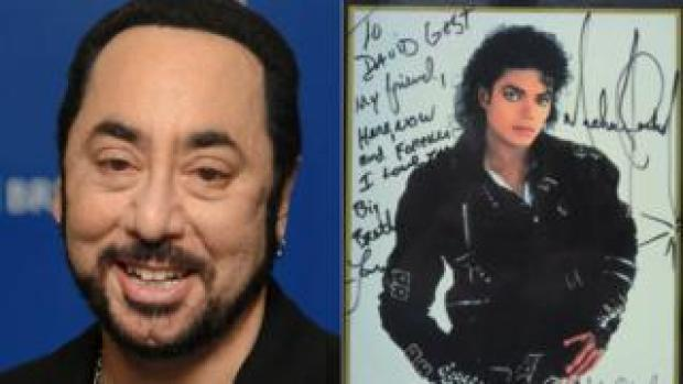 David Gest and a signed photo of Michael Jackson