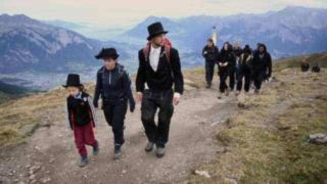 "Locals, hikers and environmental campaigners attended the ""funeral march"" for the Pizol glacier"