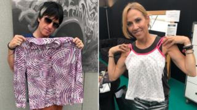 Johnny Marr and Sheryl Crow hold up the clothes they donated